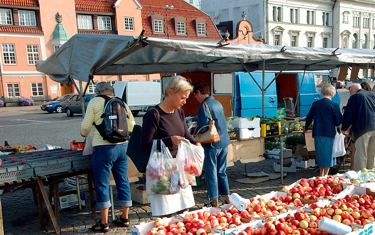 Shoppers buying from small businesses in Karlskrona's market square.