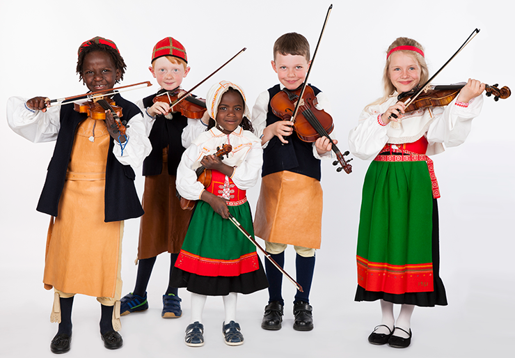 Five children, three boys and two girls of different ethnic origins, are wearing folk costumes and playing fiddles.
