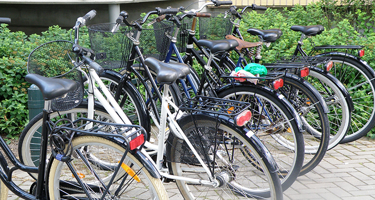 A cycle stand with six bicycles in a row.