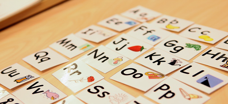 Letters of the Latin alphabet on small cards. Each card has a capital letter and a lowercase letter.