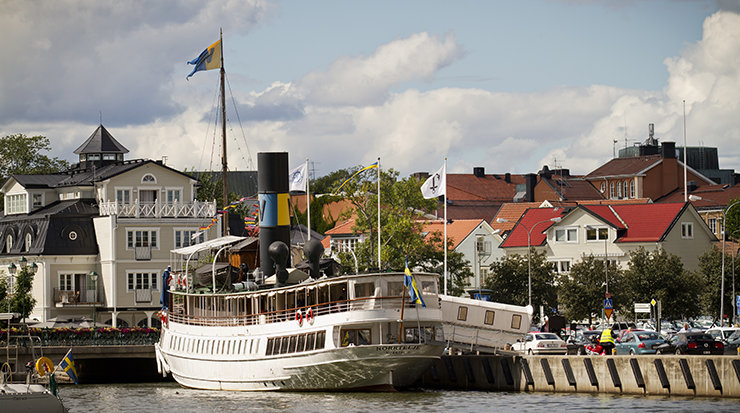 The harbour, with an archipelago boat and older buildings in the background.