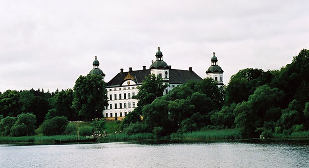Skokloster Castle. A grand white castle with black roofs.