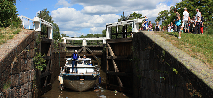 A boat passing a lock on a canal.