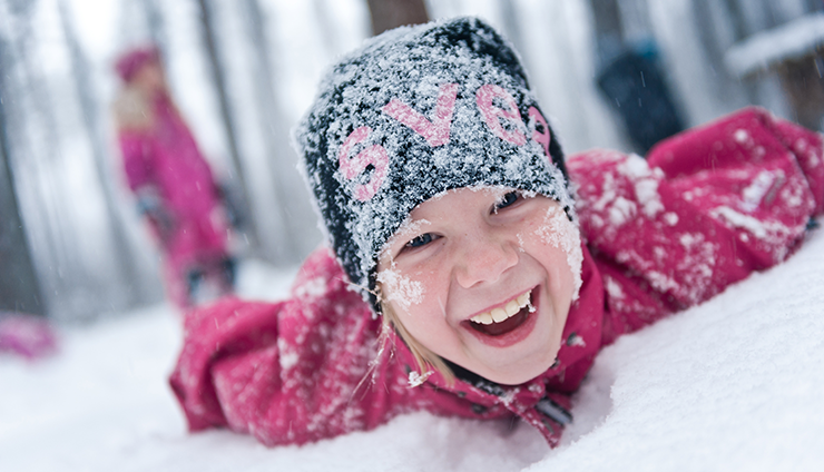 A child playing in the snow.