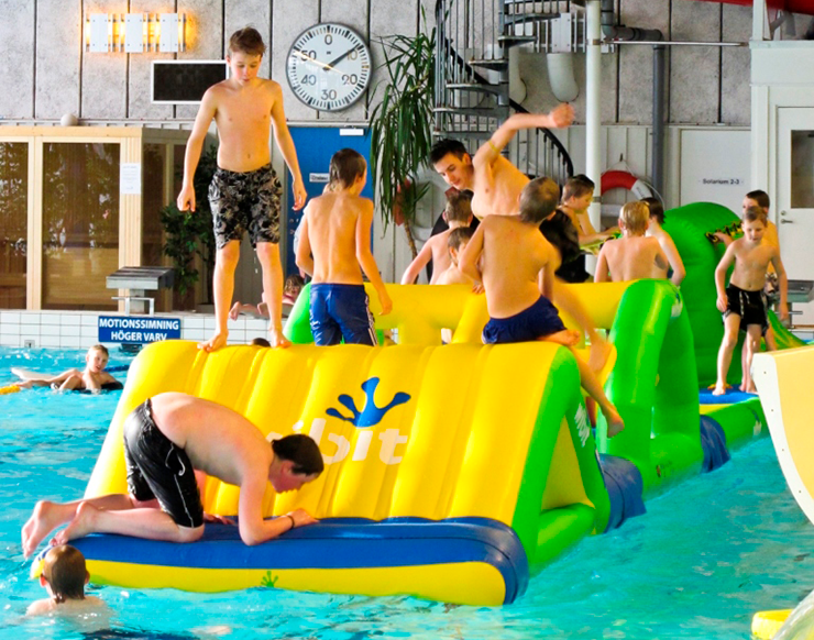 Children playing in a swimming pool.