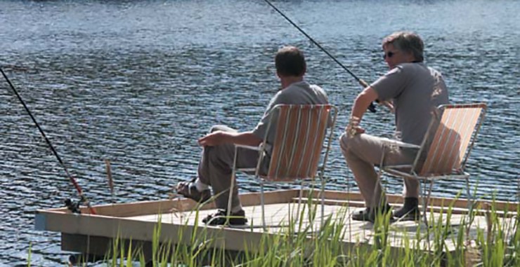 Two people fishing on a lake.