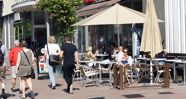 People strolling along and having coffee on Uddevalla's pedestrian street.